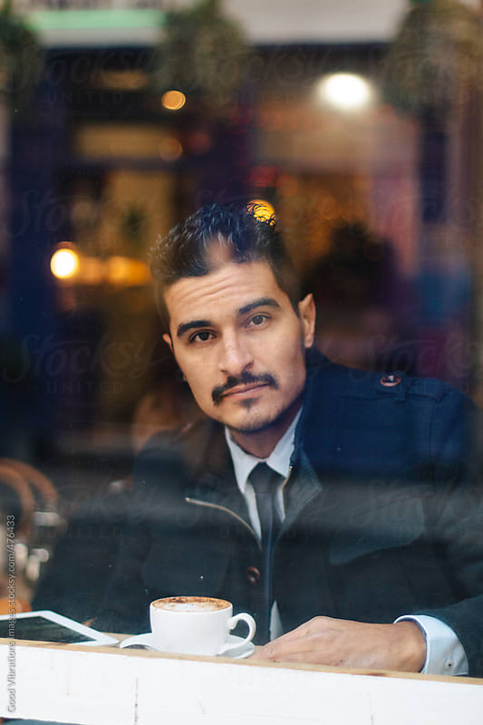 Businessman having a coffee in a bar by Good Vibrations Images for Stocksy United
