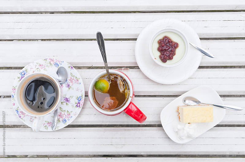 Desserts, coffee and tea on white table. by Lawren Lu for Stocksy United