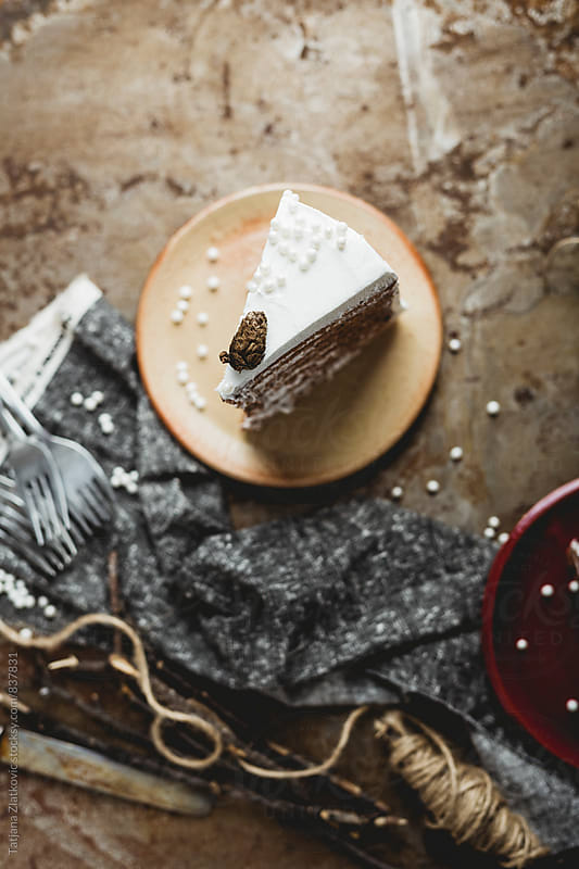 Slice of winter cake with pearls by Tatjana Ristanic for Stocksy United