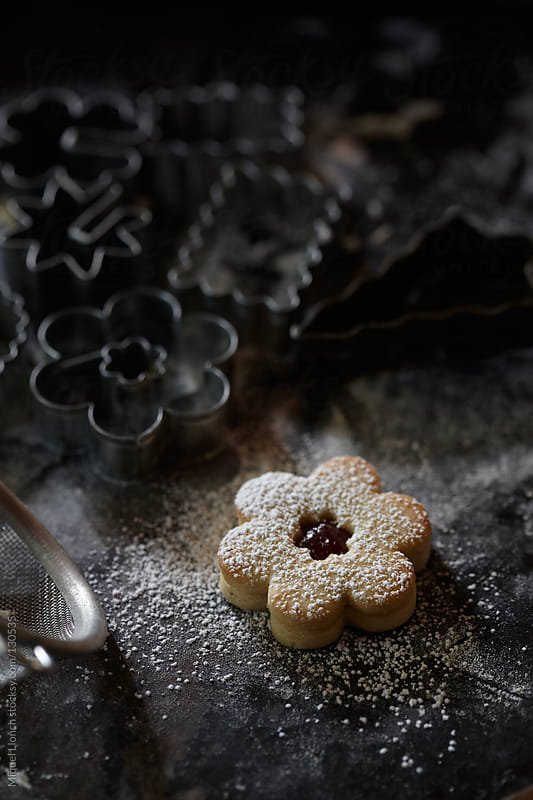 Christmas cookie with sugar and jam by Miquel Llonch for Stocksy United