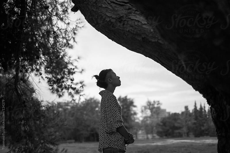 Girl among the trees by Tommaso Tuzj for Stocksy United