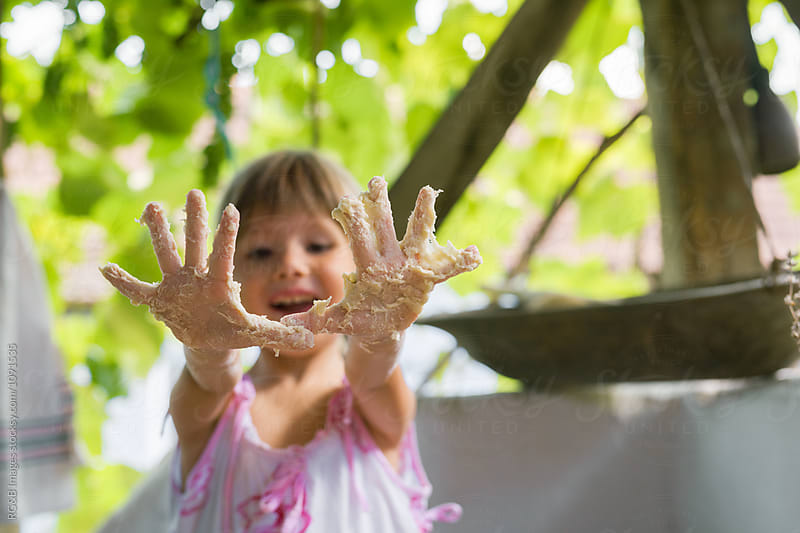 Little girl showing her dirty hands by RG&B Images for Stocksy United