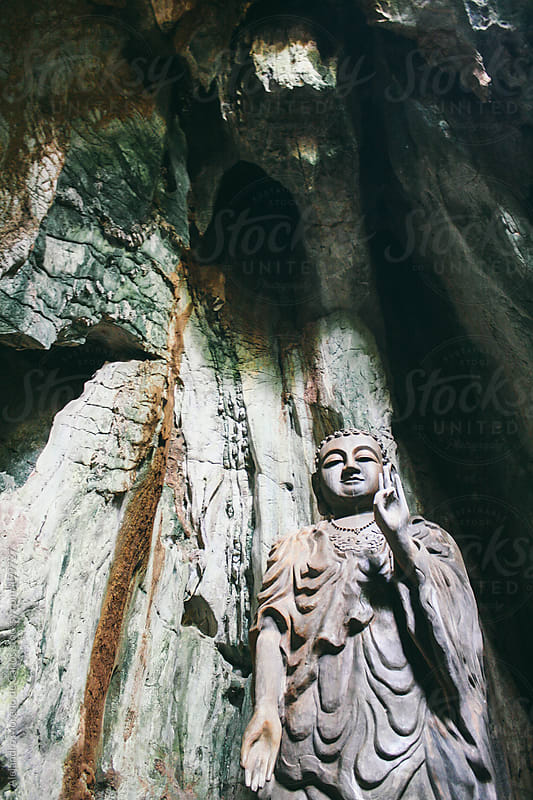Buddha statue on a cave in Vietnam by Alejandro Moreno de Carlos for Stocksy United