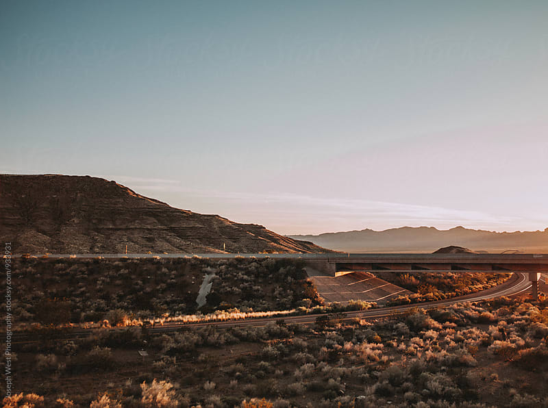 Highways cutting through desert landscape by Joseph West Photography for Stocksy United