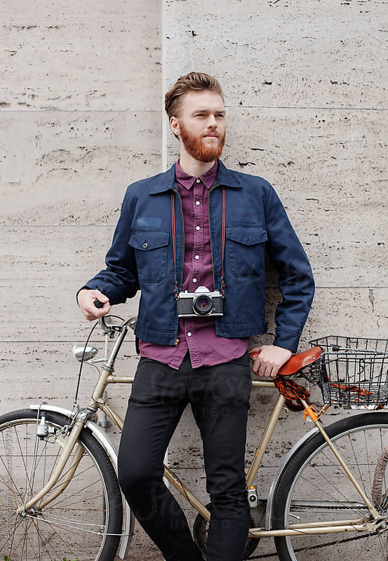 Portrait of young creative with a bike. by W2 Photography for Stocksy United