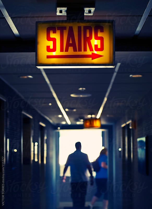 People walking Along the Corridor by VICTOR TORRES for Stocksy United