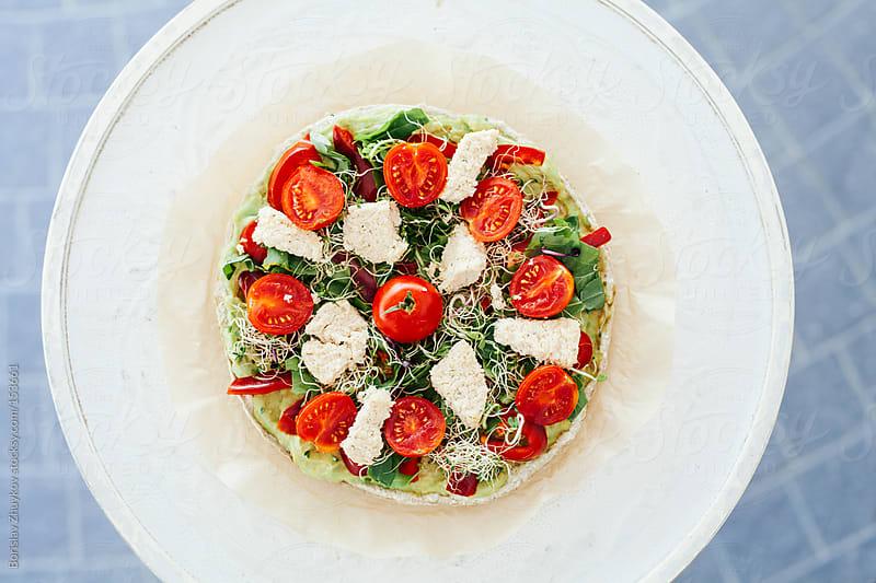 Healthy raw vegetarian salad by Borislav Zhuykov for Stocksy United