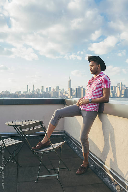 Young Black Man in Country Inspired Clothes in a New York Rooftop by Joselito Briones for Stocksy United