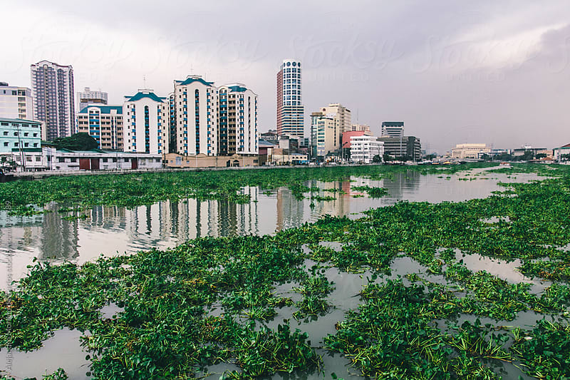 Business downtown buildings and river in Manila city, Philippines by Alejandro Moreno de Carlos for Stocksy United