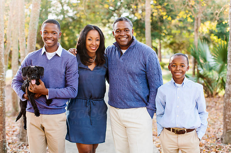 A beautiful African American family of four by Kristen Curette Hines for Stocksy United