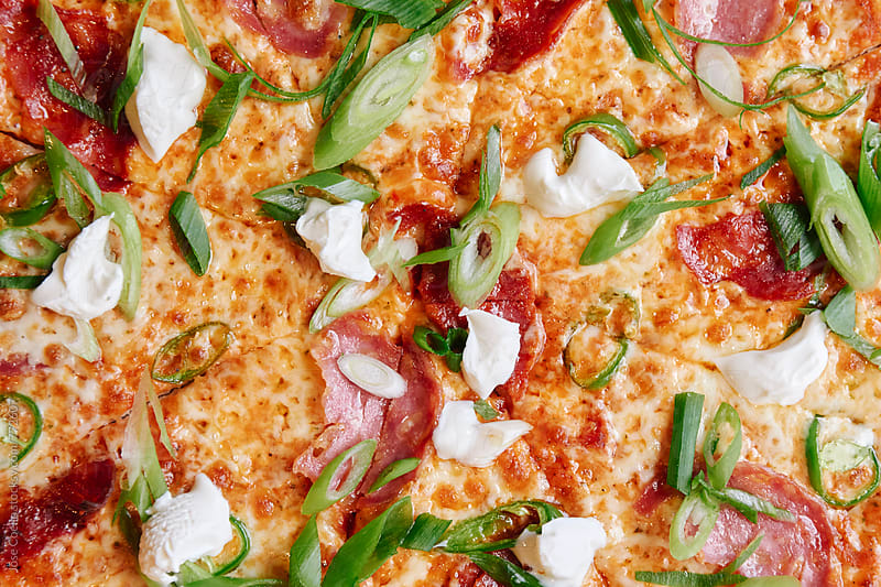 Homemade pizza by Jose Coello for Stocksy United