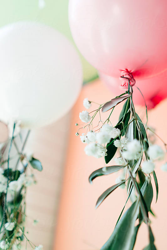 Pastel balloons with floral decor by Beatrix Boros for Stocksy United