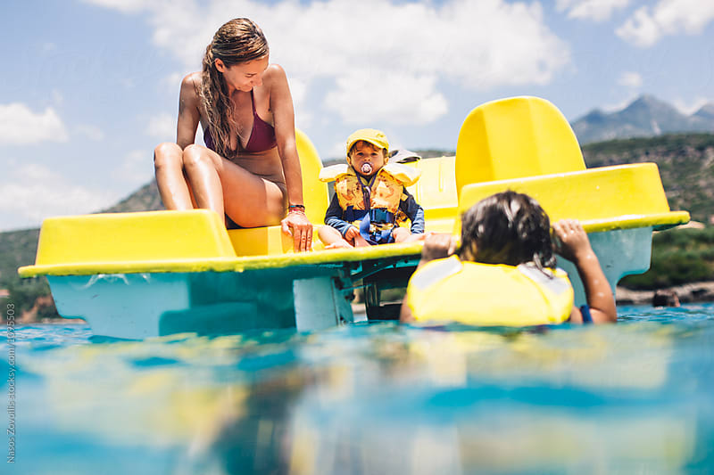 Mother and her kid on a pedal boat by Nasos Zovoilis for Stocksy United