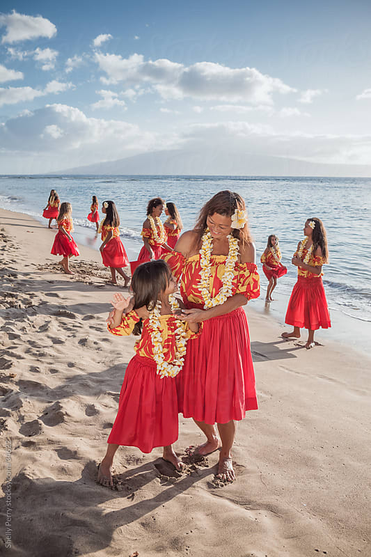 Teacher of Traditional Hawaiian Hula  and Young Student on the Beach by Shelly Perry for Stocksy United