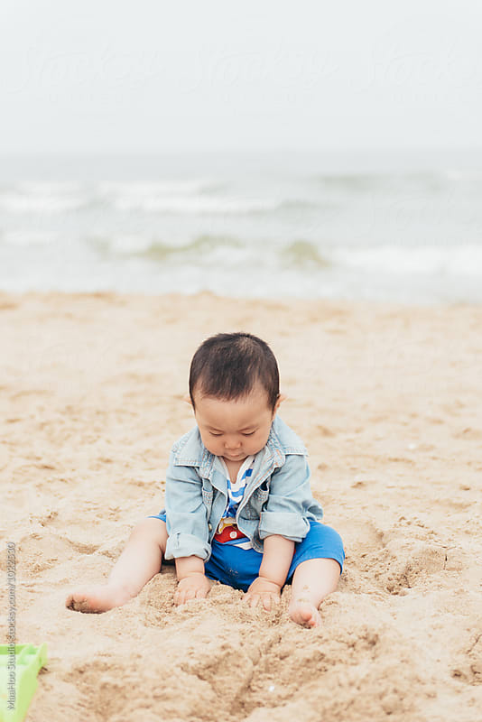 Cute baby playing in sand by MaaHoo Studio for Stocksy United