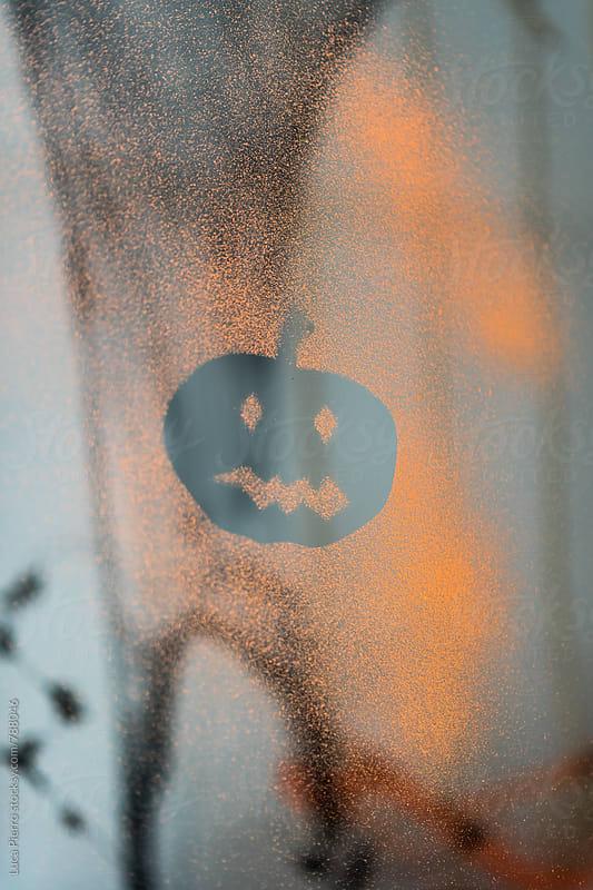 Halloween pumpkin on a glass by Luca Pierro for Stocksy United
