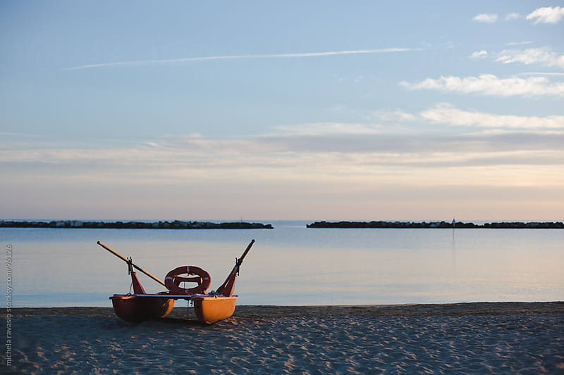 Boat on the beach at sunrise. by michela ravasio for Stocksy United