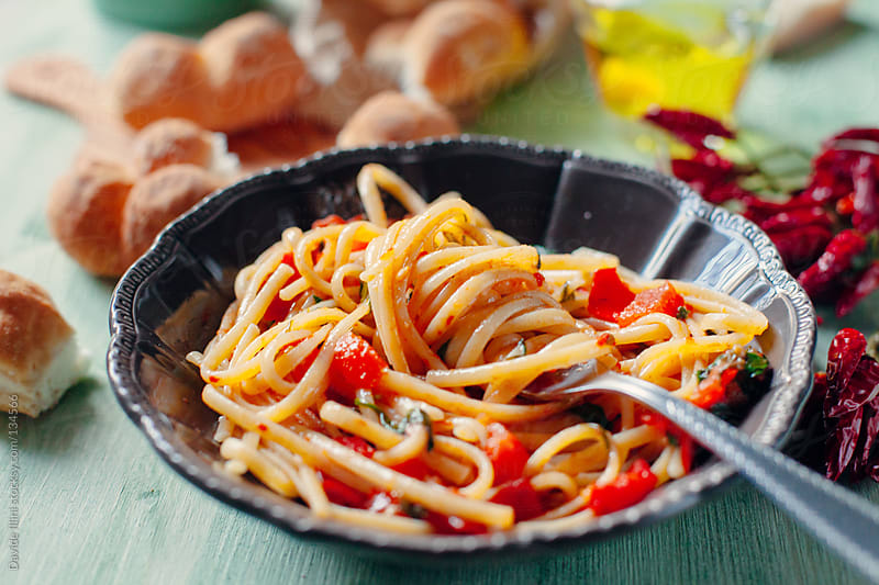 Spaghetti with fresh cherry tomatoes by Davide Illini for Stocksy United