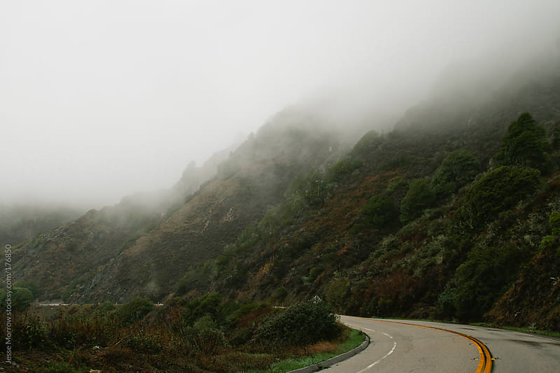 Road winding along the coast of california by Jesse Morrow for Stocksy United