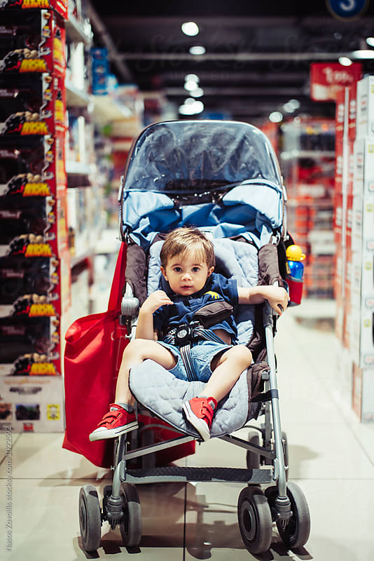 1 year old sitting in a pushchair by Nasos Zovoilis for Stocksy United