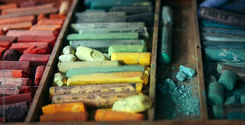 Wood box full of well loved oil pastel crayons by Carolyn Lagattuta for Stocksy United