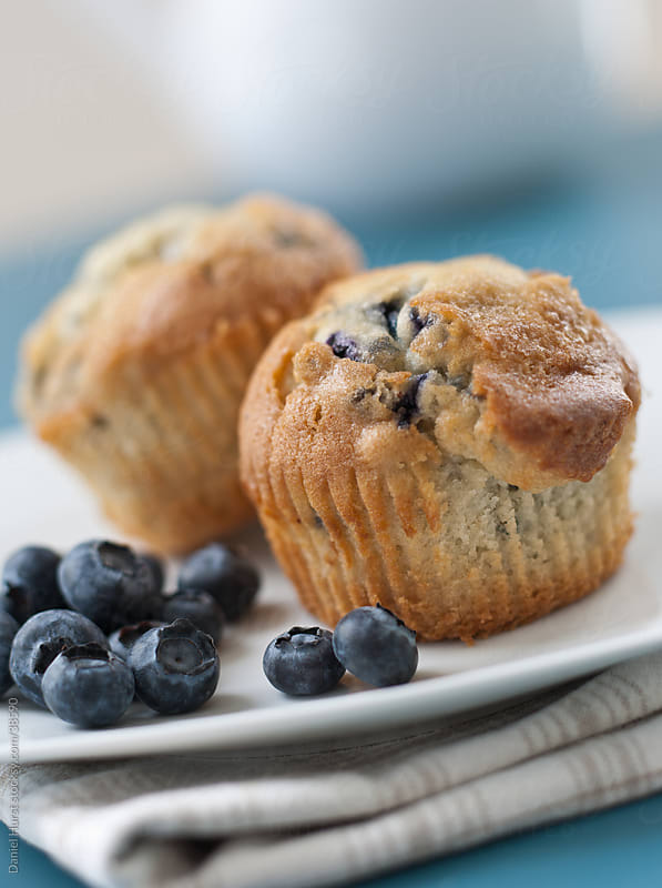Blueberry  muffins by Daniel Hurst for Stocksy United