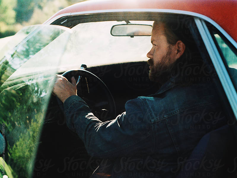 Man in car by Michael Spear for Stocksy United