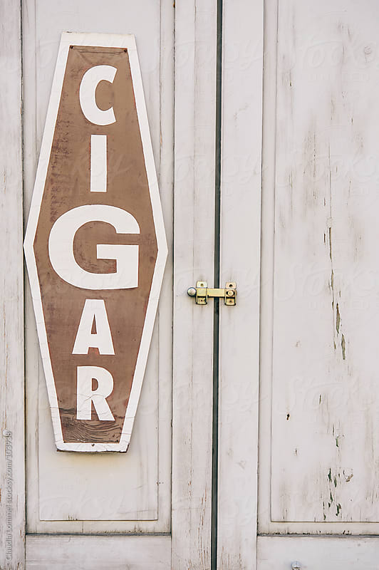 Old Cigar Sign by Claudia Lommel for Stocksy United