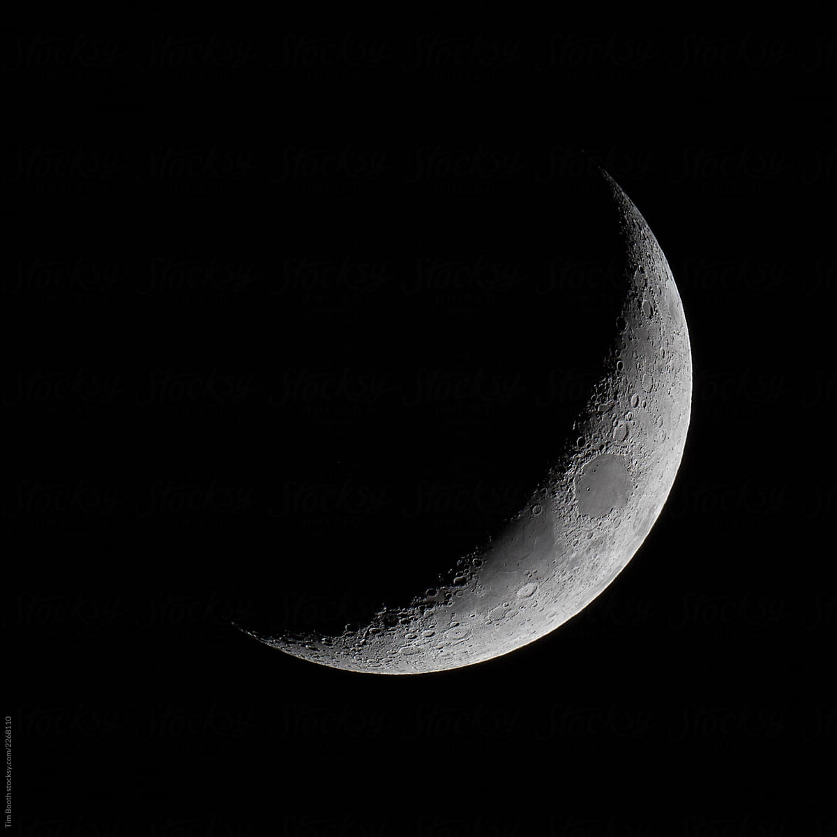 The crescent moon in the night sky. by Tim Booth - Stocksy ...