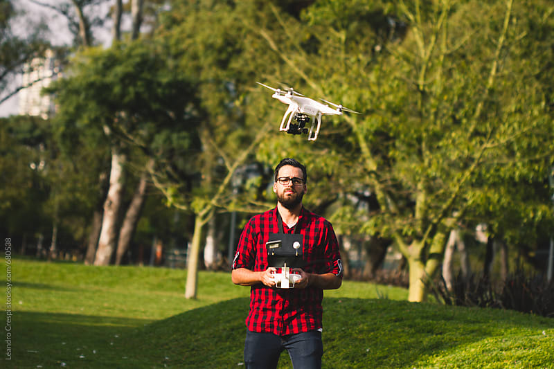 Man flying drone by Leandro Crespi for Stocksy United