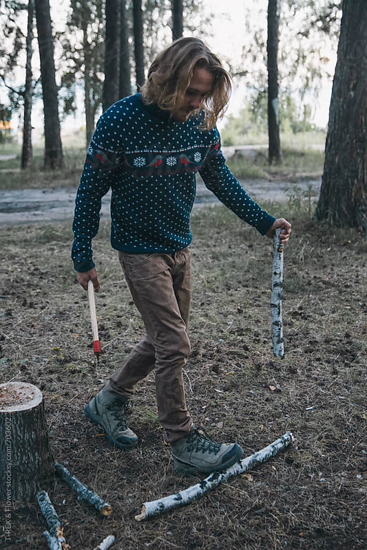 Traveler  chopping wood by Danil Nevsky for Stocksy United