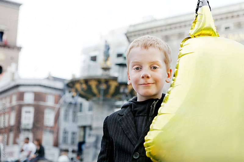 Boy with a balloon in Copenhagen, Denmark by IDS Photography for Stocksy United