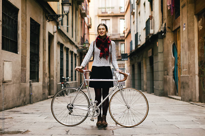 Chic woman with her vintage bicycle on the street. by BONNINSTUDIO for Stocksy United