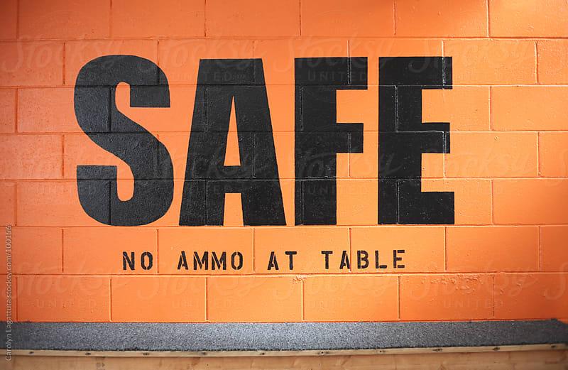 A safe table at the gun range by Carolyn Lagattuta for Stocksy United