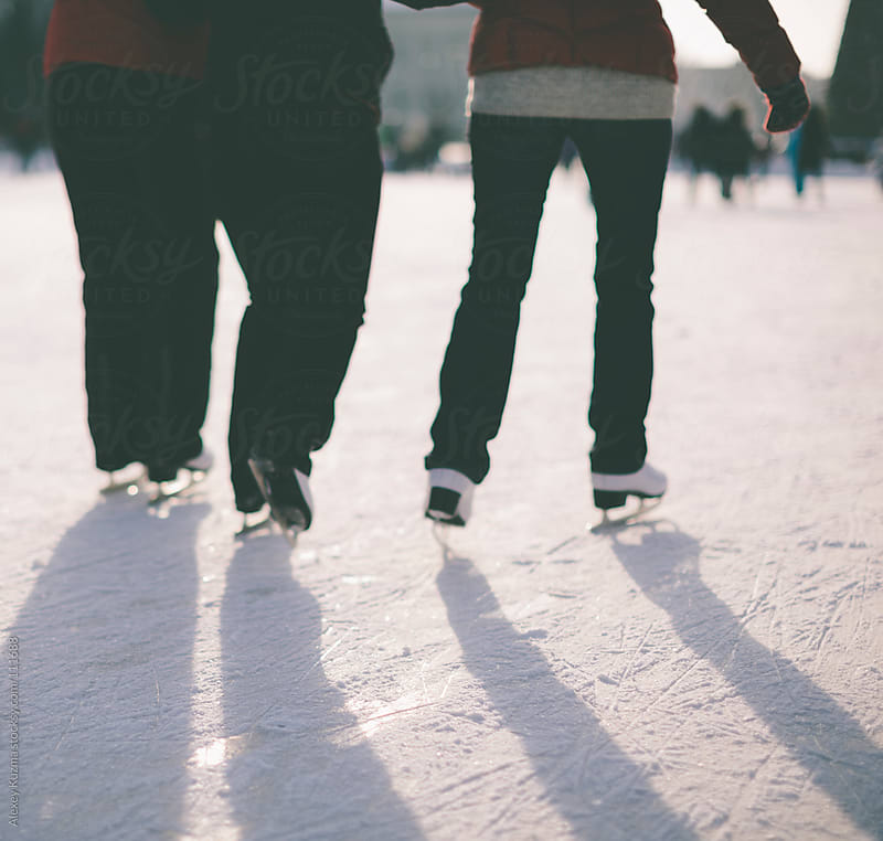 ice skating people by Alexey Kuzma for Stocksy United