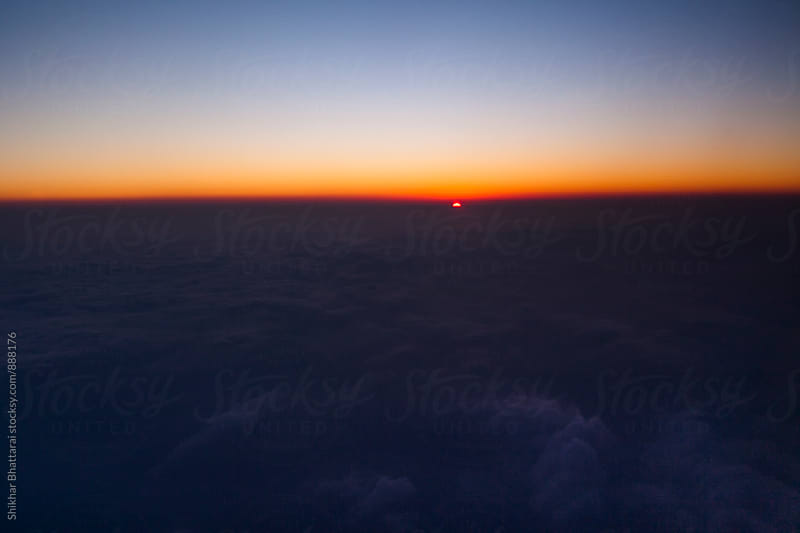 Sunset as seen from a airplane. by Shikhar Bhattarai for Stocksy United