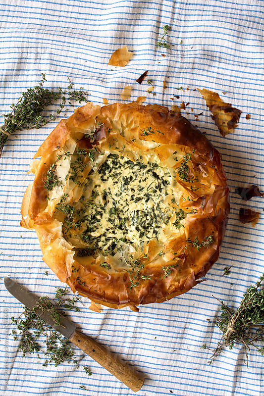 Food: Spanakopita spinach and cream filo pie  by Pixel Stories for Stocksy United
