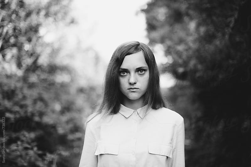 Portrait of a girl in a shirt by Svetlana Shchemeleva for Stocksy United