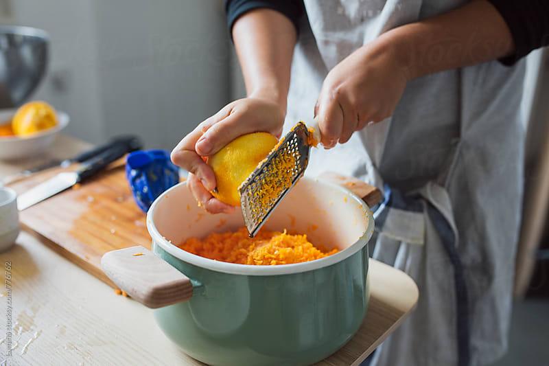 Woman Grating Lemon by Lumina for Stocksy United