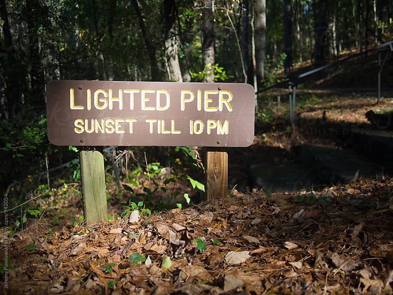 Sign for lighted pier on the texas border by Jeremy Pawlowski for Stocksy United
