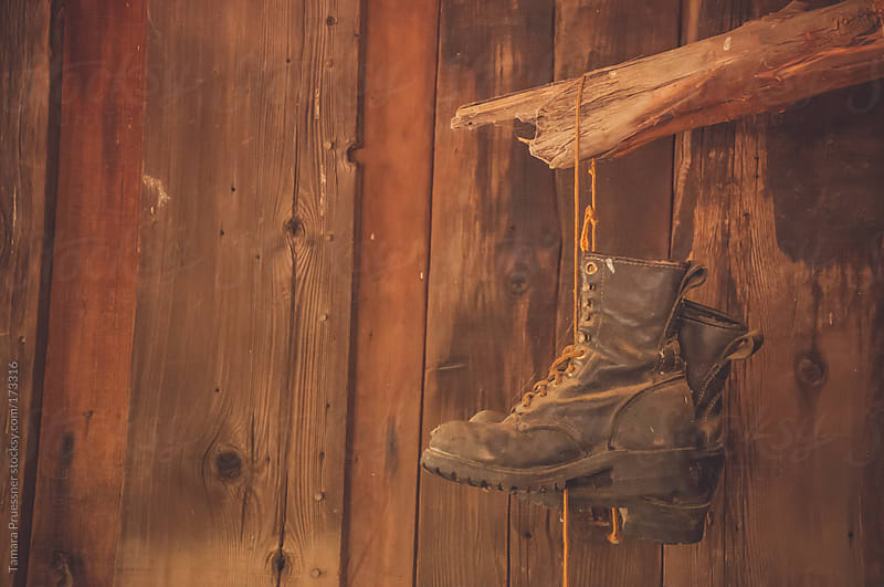 Image Of Hanging, Dusty Boots by Tamara Pruessner for Stocksy United