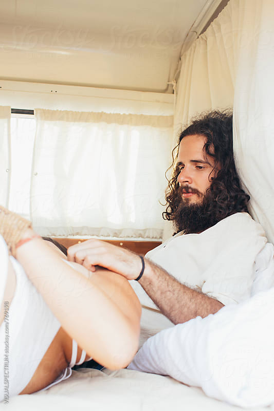Bearded Male Hippie With Girlfriend in White Stylish Camper Van by Julien L. Balmer for Stocksy United