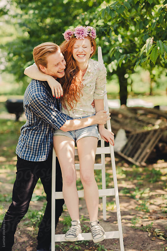 Smiling Ginger Couple in an Orchard by Lumina for Stocksy United