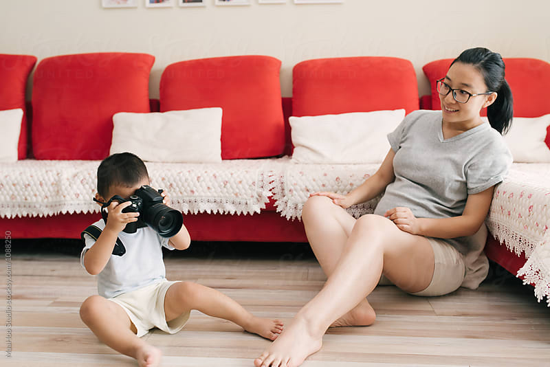 Adorable toddler boy take photos for his mother at home by Maa Hoo for Stocksy United