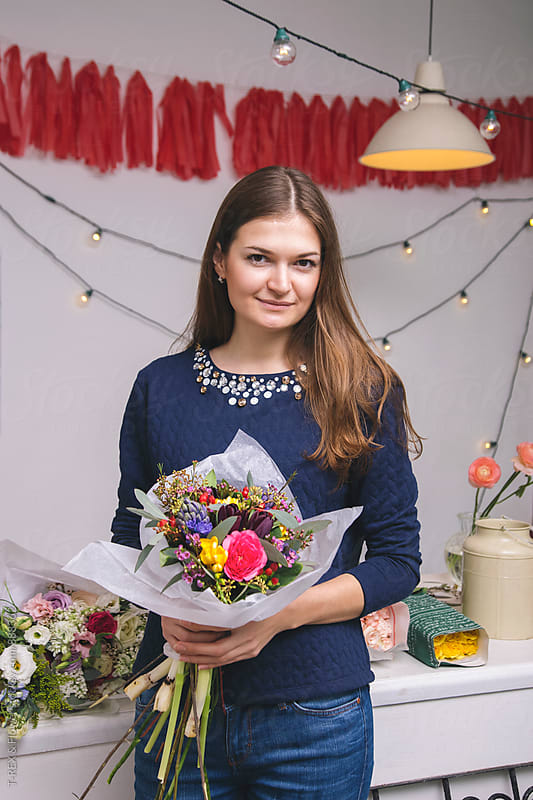 Portrait of female florist with beautiful bouquet by Danil Nevsky for Stocksy United