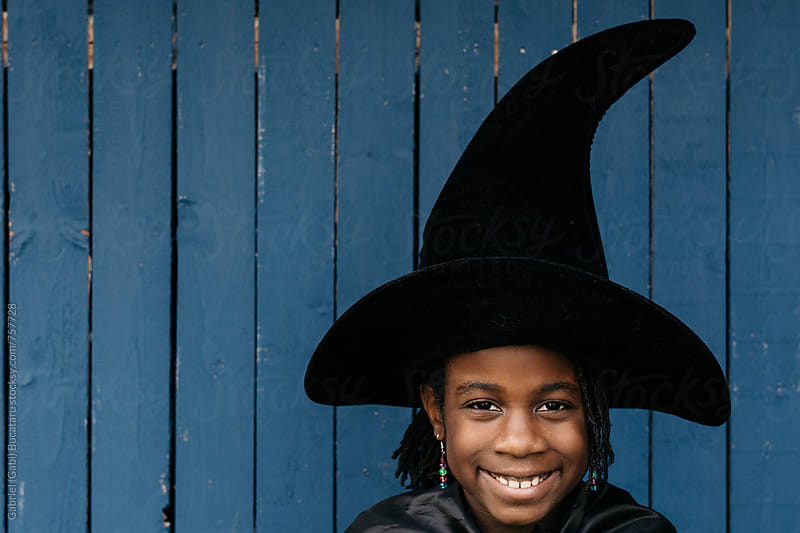 Smiling black girl in Halloween costume by Gabriel (Gabi) Bucataru for Stocksy United