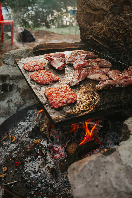 Meat on grill outdoor by Giada Canu for Stocksy United