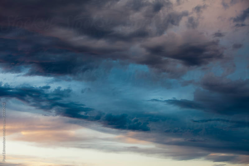 Dark and stormy sky at dusk, Utah by Paul Edmondson for Stocksy United