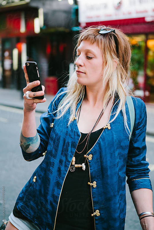 Attractive woman using her mobile phone in london by kkgas for Stocksy United