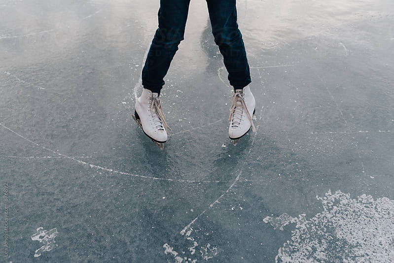 skates on ice by Léa Jones for Stocksy United